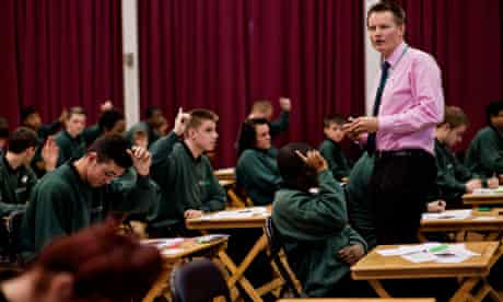 Teacher Nick House leads the 'walking talking mock' English GCSE exam at Greenshaw high in Sutton