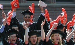 Harvard Business School students cheer as their MBA degrees