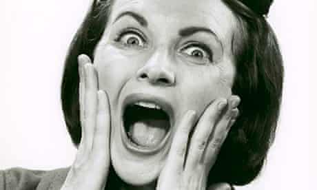 A woman gasps in surprise