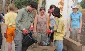 students volunteering in Gambia