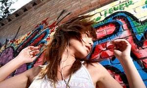 Teenage Girl Dancing And Listening To Music