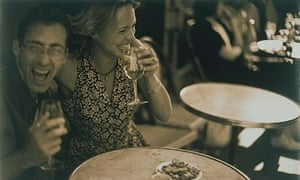 couple laughing in a cafe