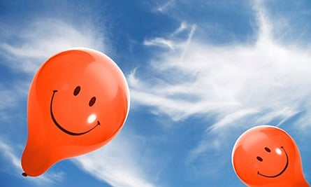 smiley face balloons in blue sky