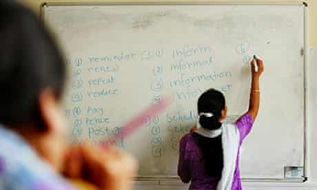 woman writing words on a whiteboard