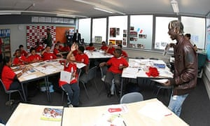 bacary sanga from arsenal in classroom with pupils