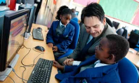 Stephen Twigg talking to children at a London primary school