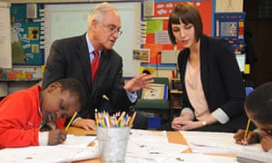 Sir Michael Wilshaw speaks to teacher Kim Clark during a visit to Fairlawn primary school in London