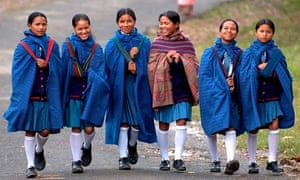 Schoolgirls in India, where private schools must give 25% of places to pupils from poor backgrounds