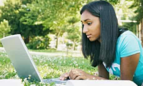 Student on laptop on grass