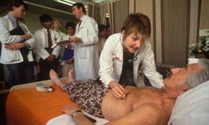 Junior doctor checks patient