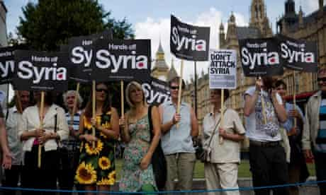People take part in a protest against western military action in Syria
