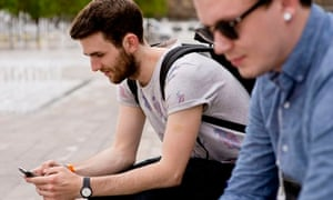 male student on mobile phone