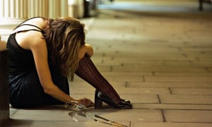 young woman on pavement after drinking
