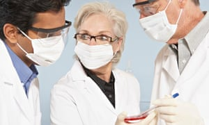 Scientists wearing surgical masks