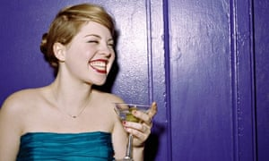 Young woman drinking martini