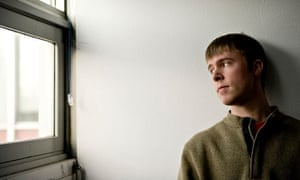 sad male student lonely looking out the window