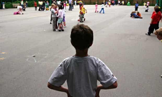 child standing alone in a playground