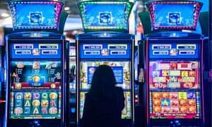 young woman at a slot machine gambling