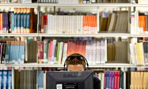 lone male student working in library