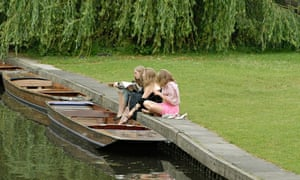 Cambridge students relaxing by the river Cam