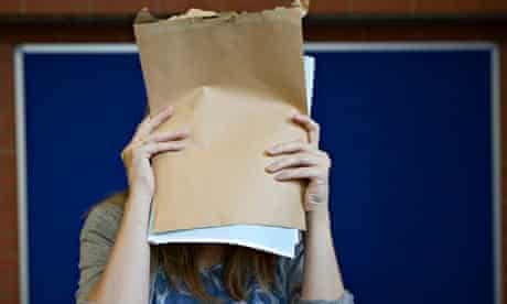 student covering face with a-level results