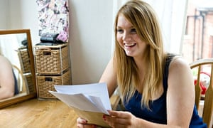 A female student nervously reads her exam results.. Image shot 2010. Exact date unknown.