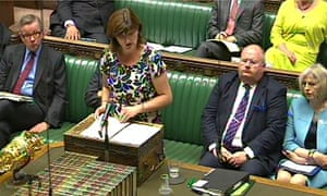 Michael Gove looks on as the new education secretary, Nicky Morgan, answers questions.