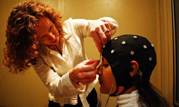 scientist performing brain experiment