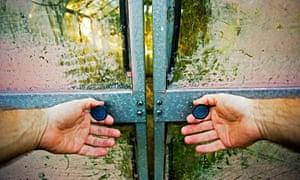 hands on door