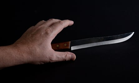 Knife and hand.