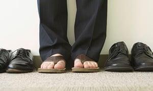 Businessman wearing flip flops next to dress shoes