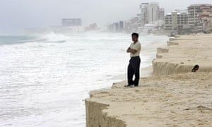 Costal erosion in Mexico:  on the beach in Cancun as Hurricane Ida passes miles offshore
