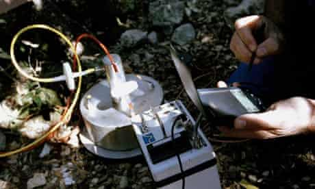 A researcher collects data from an electronic device to monitor climate change.