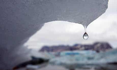 An iceberg melts, drips water in Kulusuk Bay, eastern Greenland