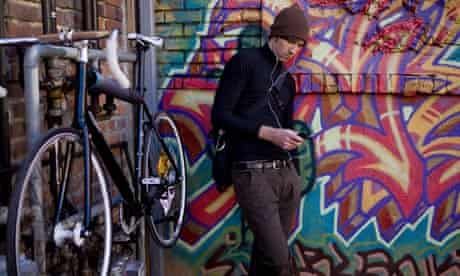 Bike blog: cyclist listening to iPod and MP3