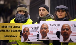 COP15 activists holding posters showing US President Barack Obama