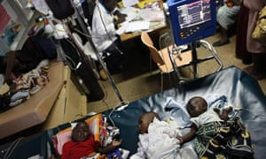 Three babies with severe malaria receive a blood transfusion in the Siaya hospital in Western Kenya