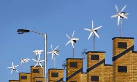 COP15 RENEWABLE ENERGY :  Wind turbines sit atop a development of new houses, CROYDON