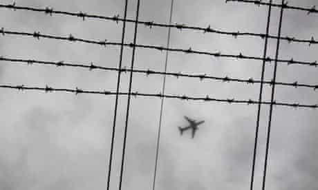 COP15 Airplane and carbon : plane flies through low cloud in Sydney, Australia