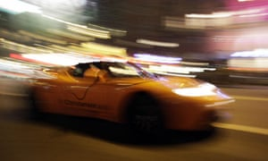 COP15 Copenhagen diary The Tesla roadster, an all-electric sports car, drives near Town Hall Square