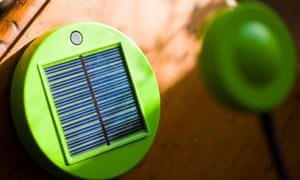 Solar-powered lamp on wooden table