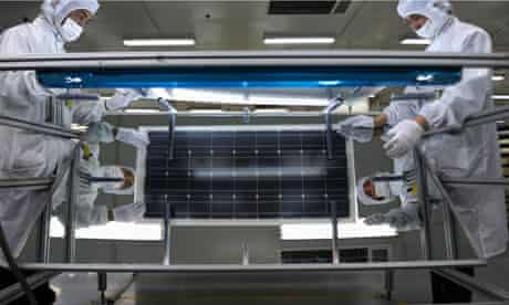 China solar industry : Employees inspect solar panels at a workshop in factory in Hangzhou