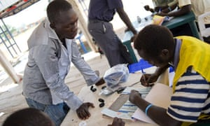 MDG : South Sudan Referendum : An official records the details of a voter in Juba South Sudan
