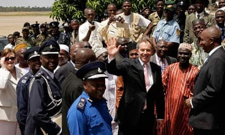 British Prime Minister Tony Blair waves as he arrives at Lungi Airport in Sierra Leone