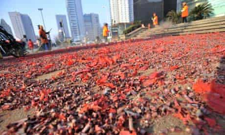 City cleaners clear away burnt firecracker crumbs in Wuhan china