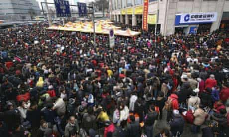 Chinese people crowd at a long-distance bus station in Nanjing, China