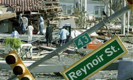 Residents inspect damage left by Hurricane Katrina in Biloxi, Mississipp