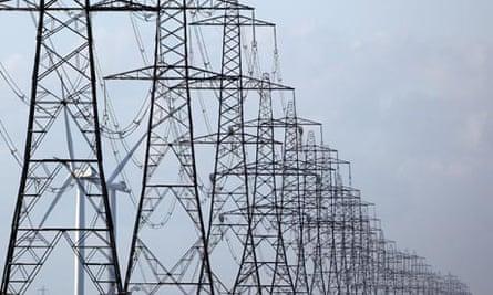 Carbon targets : pylons running across Romney Marsh  in Dungeness