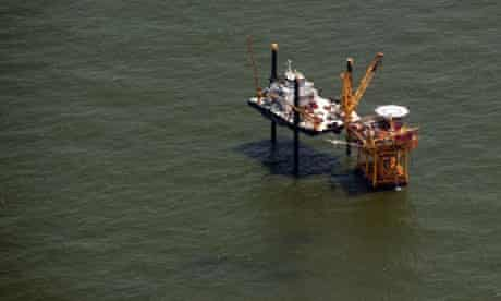 An offshore oil rig sits in the Gulf of Mexico near Grand Isle, Louisiana