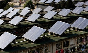 Solar energy in Spain : Solar panels adorn the top of graves in cemetery in the Barcelona suburb